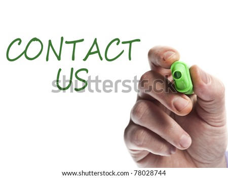Hand write with green marker Contact us - stock photo
