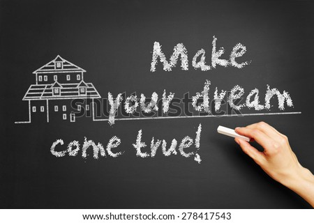 "Hand writes ""Make your dream come true!"" on blackboard - stock photo"