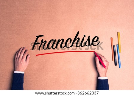 Hand writing a single word Franchise on paper - stock photo