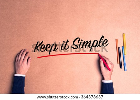 Hand writing a single word Keep it Simple on paper - stock photo