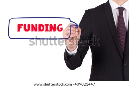 Hand writing a word FUNDING on white board - stock photo