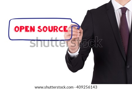 Hand writing a word OPEN SOURCE on white board - stock photo