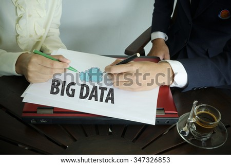 hand writing Big data text with two business person , team work concept - stock photo