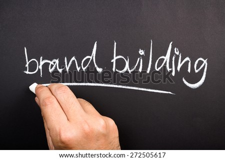 Hand writing Brand Building topic on chalkboard - stock photo