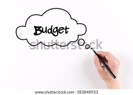 Hand writing Budget on white paper, View from above - stock photo