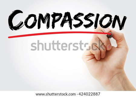 Hand writing Compassion with marker, concept background - stock photo