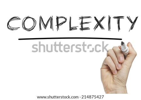 Hand writing complexity on a white board - stock photo