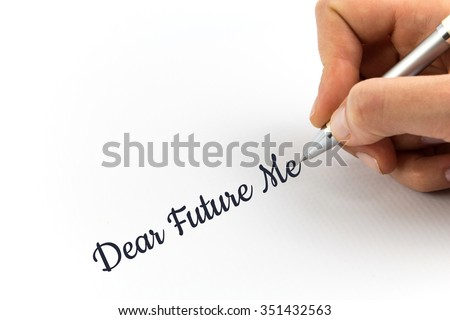 """Hand writing """"Dear Future Me"""" on white sheet of paper. - stock photo"""
