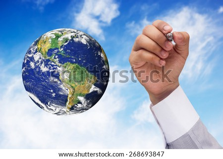 hand writing earth on blue sky backgrounds.Elements of this image furnished by NASA - stock photo