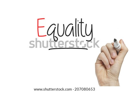 Hand writing equality on a white board - stock photo
