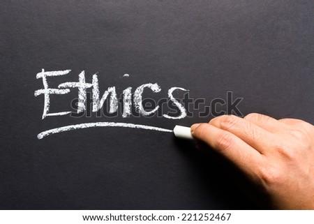Hand writing Ethics topic on chalkboard - stock photo