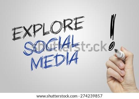Hand writing explore social media on grey background - stock photo