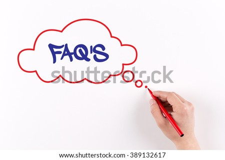Hand writing FAQ'S on white paper, view from above - stock photo