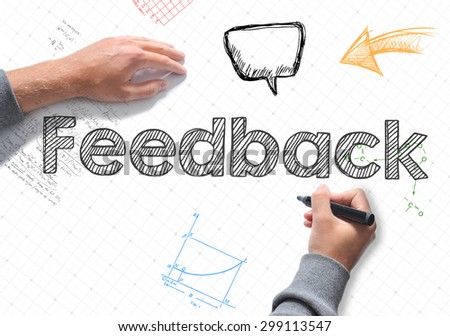 Hand writing Feedback word on white sheet of paper - stock photo