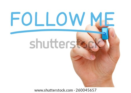 Hand writing Follow Me with blue marker on transparent wipe board. - stock photo