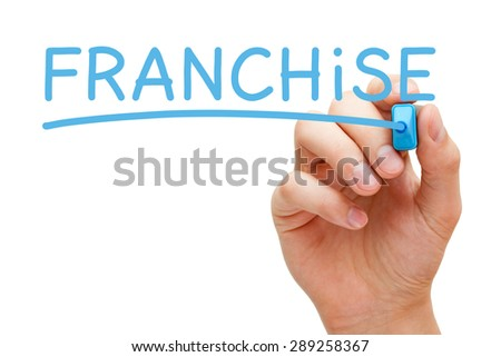 Hand writing Franchise with blue marker on transparent wipe board. - stock photo