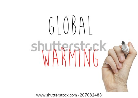 Hand writing global warming on a white board - stock photo