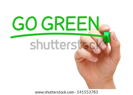 Hand writing Go Green with green marker on transparent wipe board. - stock photo