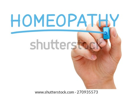 Hand writing Homeopathy with blue marker on transparent wipe board. - stock photo