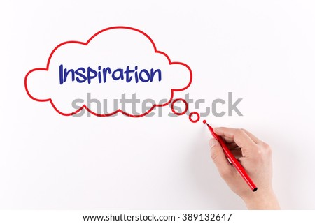 Hand writing Inspiration on white paper, view from above - stock photo