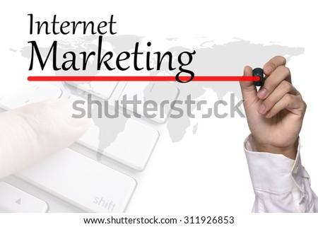 Hand writing Internet marketing over white - stock photo