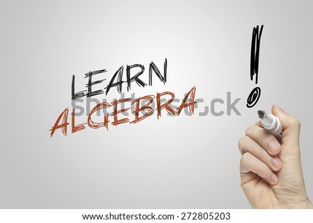 Hand writing learn algebra on grey background - stock photo