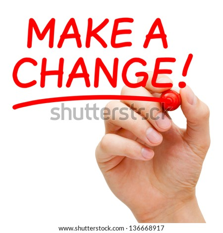 Hand writing Make a Change with red marker on transparent wipe board. - stock photo