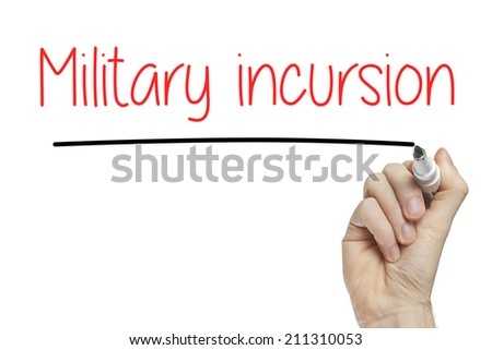 Hand writing military incursion on a white board - stock photo