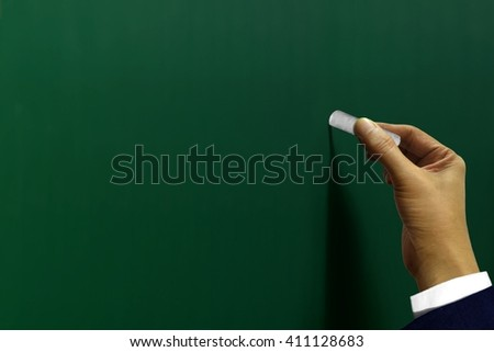 Hand writing on blackboard - stock photo