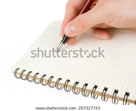 Hand writing on empty notepad (notebook) isolated on white - stock photo