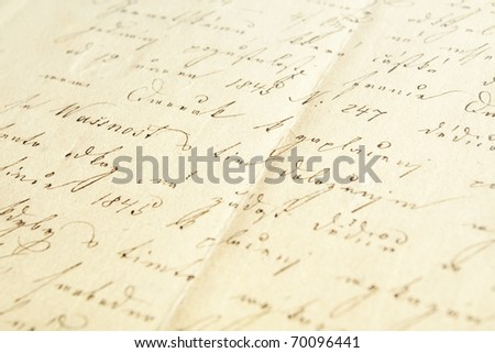 Hand writing on very old paper - stock photo