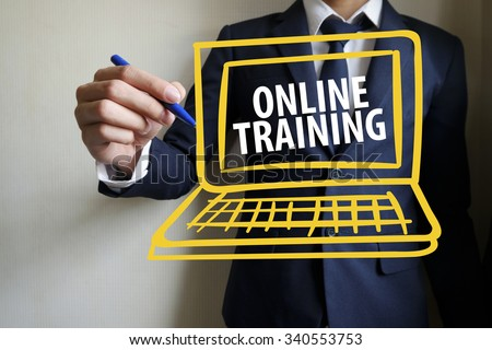 hand writing online training text with laptop , business idea , business concept - stock photo