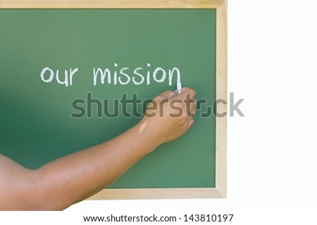 hand writing, our mission on green board - stock photo