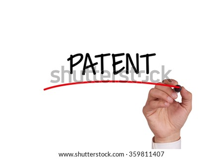 Hand writing PATENT with Black Marker on Transparent Wipe Board - stock photo
