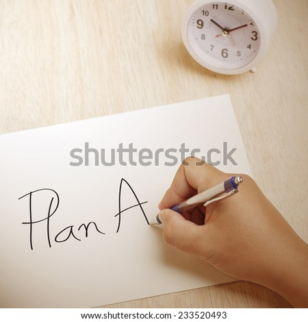 Hand writing Plan A on paper sheet - stock photo