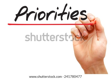 Hand writing Priorities with red marker, business concept - stock photo