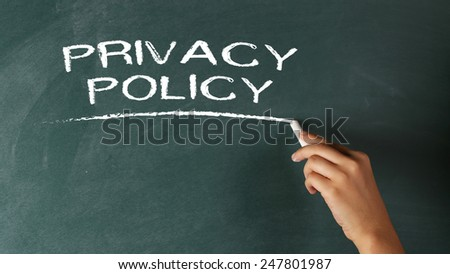 Hand Writing Privacy Policy on Chalkboard  - stock photo