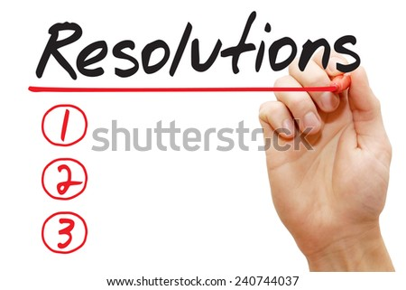 Hand writing Resolutions List with red marker, business concept - stock photo