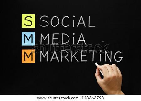 Hand writing Social Media Marketing with white chalk on blackboard. - stock photo