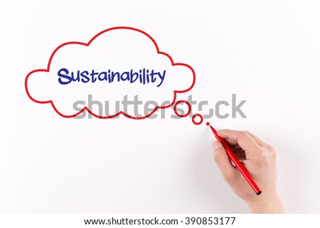 Hand writing Sustainability on white paper, view from above - stock photo