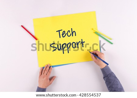 Hand writing Tech Support on yellow paper - stock photo