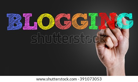 Hand writing the text: Blogging - stock photo