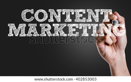 Hand writing the text: Content Marketing - stock photo