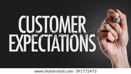 Hand writing the text: Customer Expectations - stock photo