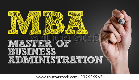 Hand writing the text: MBA - stock photo