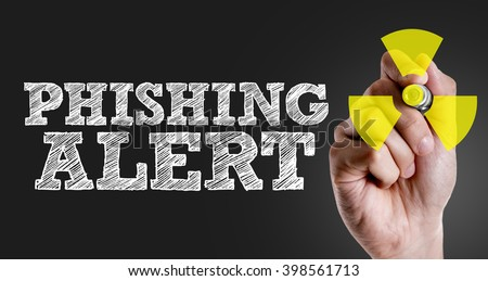 Hand writing the text: Phishing Alert - stock photo