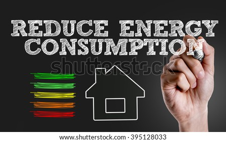 Hand writing the text: Reduce Energy Consumption - stock photo