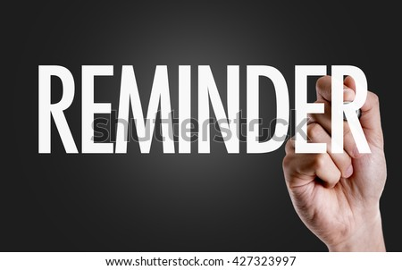 Hand writing the text: Reminder - stock photo