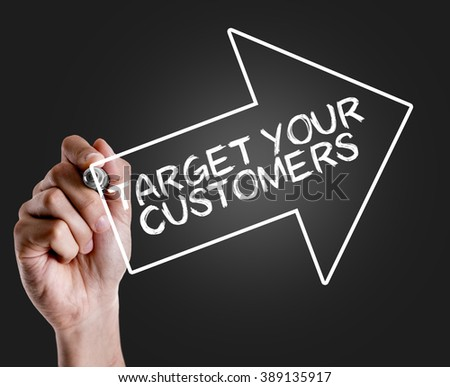 Hand writing the text: Target Your Customers - stock photo