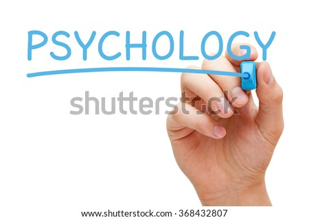Hand writing the word Psychology with blue marker on transparent wipe board. - stock photo